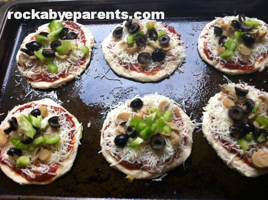 Mini Pizzas Ready for the Oven