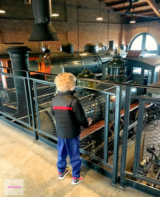 Looking at all of the old trains in the Round House at Greenfield Village